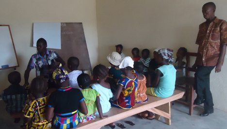 John and Moses teaching Junior Church in Baomahun