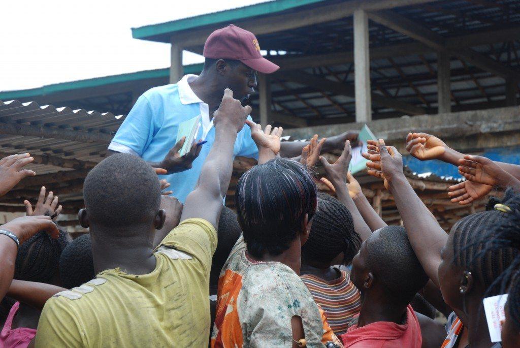 Distributing evangelism materials in Kenema