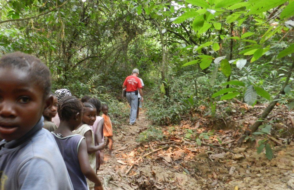 Being escorted on our way to the next village