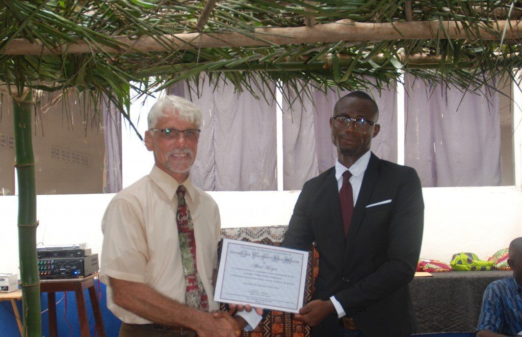 Alfred receiving his hard earned diploma